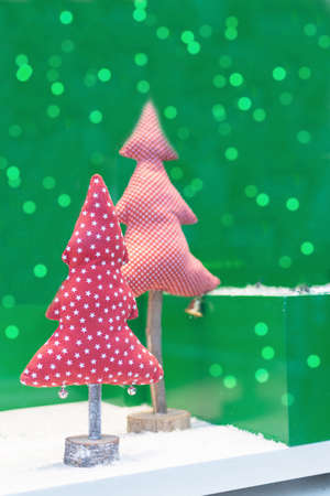 Fabric christmas tree on green background with beautiful bokeh. Handmade Christmas trees as a save nature concept. Greeting Christmas card. Imagens