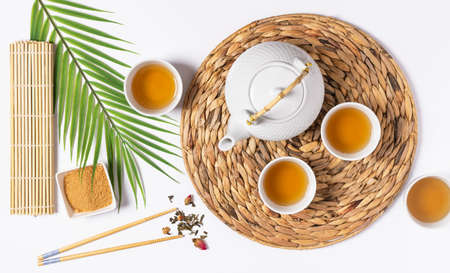 Tea ceremony with teapot and tea cups top view on white background.  Asian tea ceremony. Stock fotó