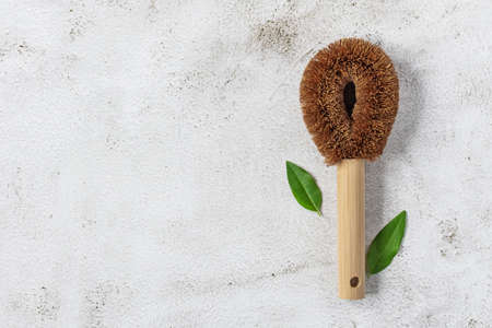 Natural eco friendly cleaning brush top view. Sustainable living concept.