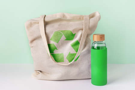 Natural cotton eco shopping bag and glass reusable water bottle.  Zero waste concept. Stock fotó