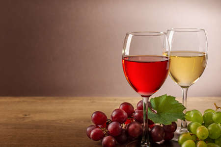 Wine composition with wine glasses and grape. Still life of glasses of red and white wine and variety of grape. Stock fotó