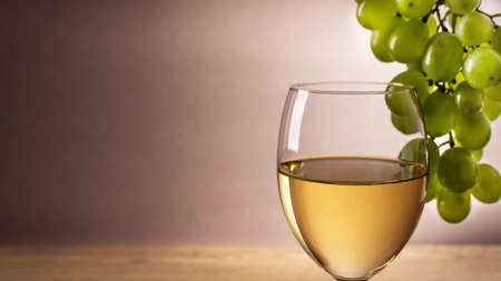 Glasse of white wine and white grape. Wine composition with copy space for design. Still life of wine and grape.