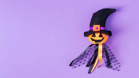 Halloween background with creative pumpkin toy top view. Halloween background.