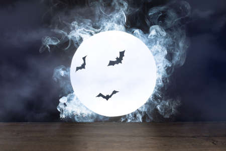 Halloween background. Spooky night with full moon and wooden table. Halloween scary night. Stock fotó