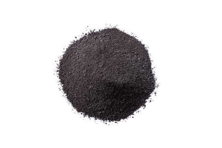 Dry black cosmetic clay isolated on white background. Heap of black charcoal cosmetic clay.