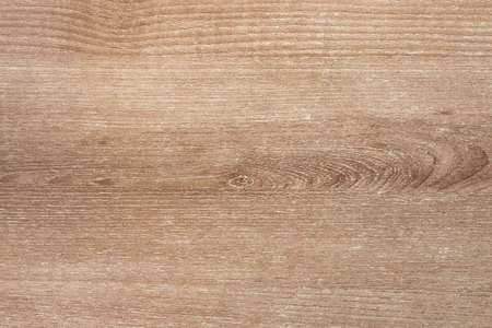 Light brown wooden background top view. Wooden texture closeup.