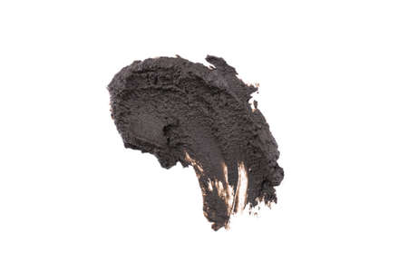 Wet black cosmetic clay smear isolated on white background. Abstract sample of black cosmetic clay. Facial beauty mask for skin detox. Stock fotó