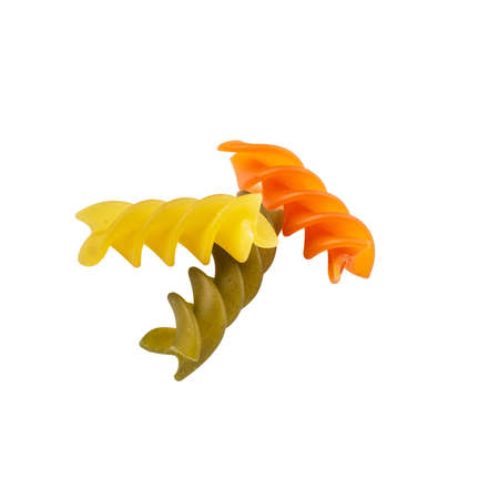 Raw tricolor Fusilli gluten free pasta isolated on white background. Italian colorful macaroni. Stock fotó