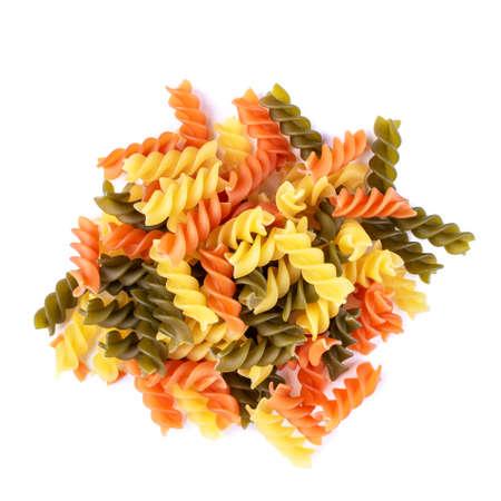 Heap of raw tricolor Fusilli gluten free pasta isolated on white background. Italian colorful macaroni.