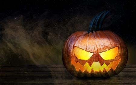 Halloween Pumpkin on a Wooden desk At Night