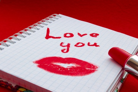 I love you inscription, lipstick is red, a trace of a kiss, a trace of lipstick Stock Photo