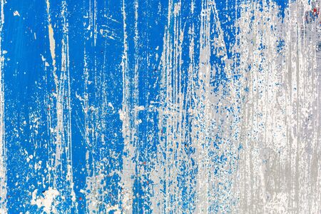 Blue and white texture grunge background. Surface covered with peeling paint, stains, scratches, stripes Stock Photo