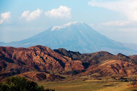 Snow cap of Mount Ararat close-up. Ice plateau. The summit of the mountain. Blue sky and majestic landscape. Panoramic view of Ararat peak from Turkey, Agri Province