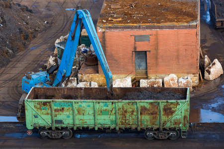 Unloading of a freight car with a crane. Freight wagon. Port unloading Stock Photo
