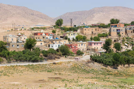 The view of Hasankeyf town and surrounding mountains, Turkey, Eastern Anatolia. Houses with water heaters and TV antennas Stock Photo