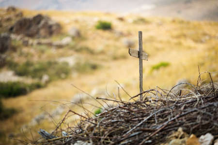 Simple wooden Religious Cross. The view of mountains in the Kadisha Valley in Lebanon. Construction of the future church. 版權商用圖片