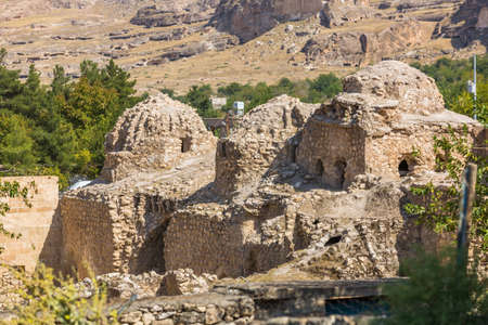 View of Hasankeyf stone houses and ruines in Turkey, Eastern Anatolia, Kurdistan
