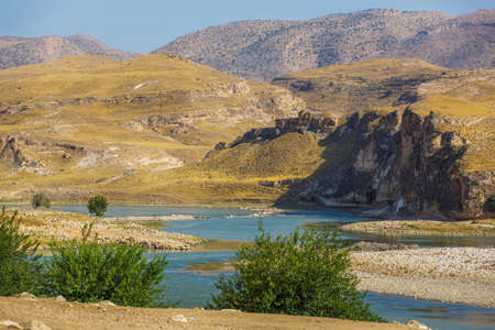 Panoramic view of the Tigris river valley. Blue water of river and mountains. Landscape near the Hasankeyf town, Turkey