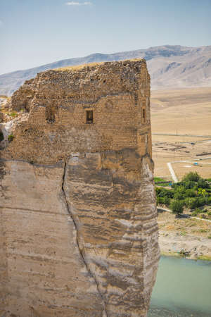 The castle of Hasankeyf, Turkey, Eastern Anatolia. View of the citadel on the rock with mountains and the Tigris river on the background