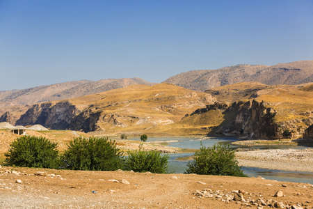 Panoramic view of the Tigris river valley. Blue water of river and mountains. Landscape near the Hasankeyf town, Turkey, Batman Province