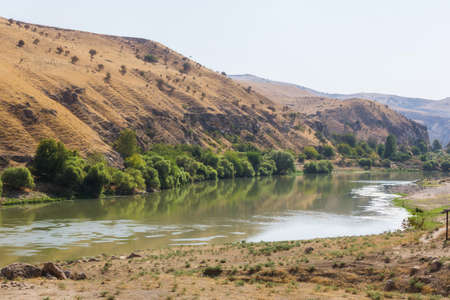 Panoramic view of the Tigris river valley. Green water of river and mountains. Landscape near the Hasankeyf town, Turkey, Batman Province Stock Photo