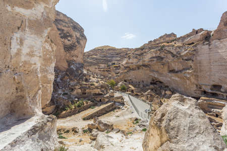 Panoramic view of Hasankeyf ancient cave houses, Turkey, Eastern Anatolia. Stone walls, in rocks, historical ruins