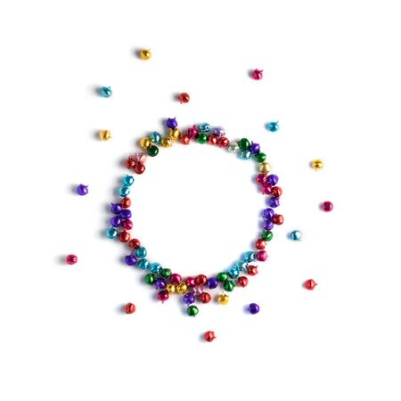 Colourful jingle bells frame on white background. Isolated. Stock Photo