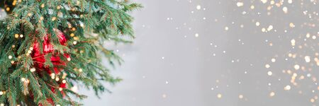 Decorated Christmas tree. Close up of Christmas decoration. Golden bokeh banner. Christmas background.