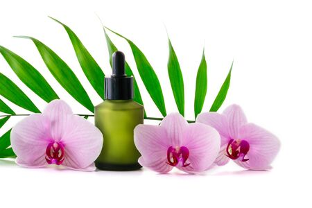 Background with natural serums bottle and orchids, isolated on white.