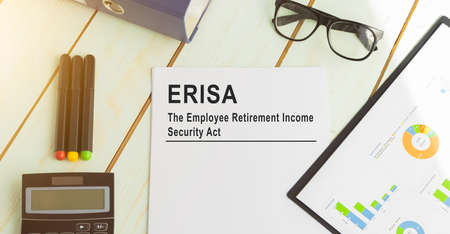 Paper with ERISA employee retirement income law on the table