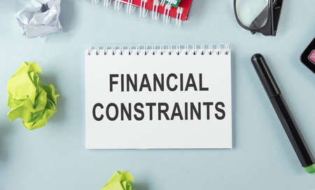 card with text FINANCIAL CONSTRAINTS, business concept image with soft focus background