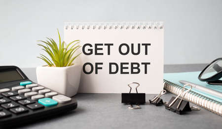 Paper note with text Get Out Of Debt 版權商用圖片