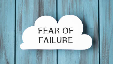 text fear of failure, isolated white background with printer and folders.business concept