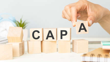 CAPA Corrective and Preventive action plans lettering on wooden cubes Stok Fotoğraf