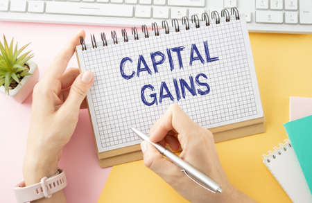 Text capital gain on the short note texture background