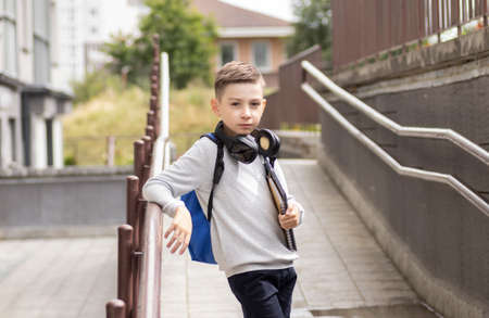 Elementary Student In Front Of His Home Smiling With Backpack