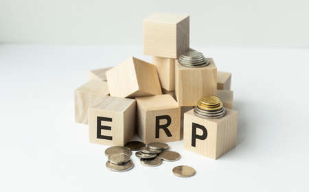 Acronym ERP- Enterprise resource planning. Wooden small cubes with letters isolated on black background with copy space available. Business Concept image.