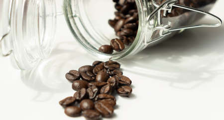 Half roasted coffee, isolated on white background.