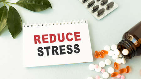 Reduce stress text concept write on notebook with pen