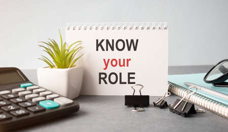 Text sign showing Know Your Role. Conceptual photo end acting outside who you actually are Play your position Striped paperboard notebook cardboard office study supplies chart paper.