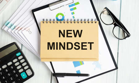 New mindset text on gray cork notice board with pencils. Flexible and innovative work approach. Success management concept