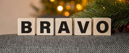 BRAVO text on a wooden cubes background