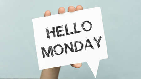 White paper with text Hello Monday. Symbol for starting a new week.