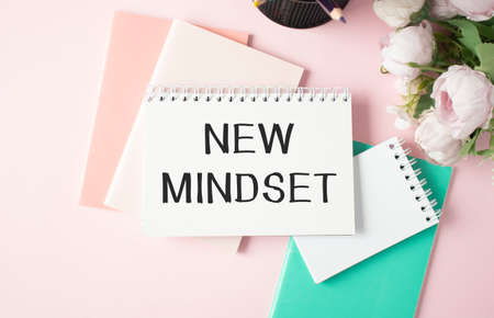 Notebook with Tools and Notes with text New Mindset business Фото со стока