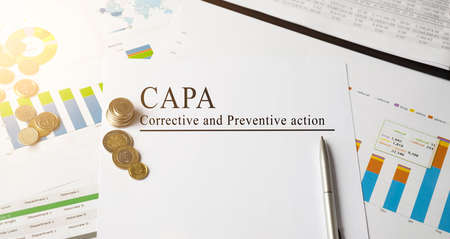 Paper with Corrective and Preventive CAPA action plans on a table Stock Photo
