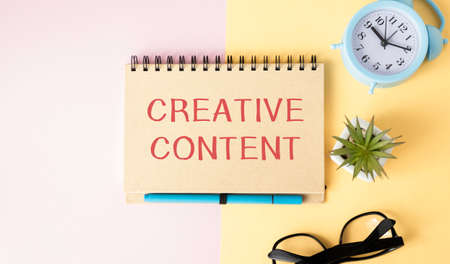 Text sign showing Creative Content. Conceptual photo providing showing with the type of content they re craving Papercraft craft paper desk square spiral notebook office study supplies.