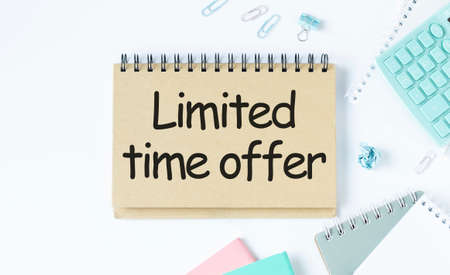 Limited time offer, Text message on white paper with notebook on wooden table, top view. business concept