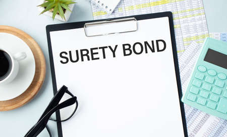 Paper with Surety Bond on a table Banque d'images