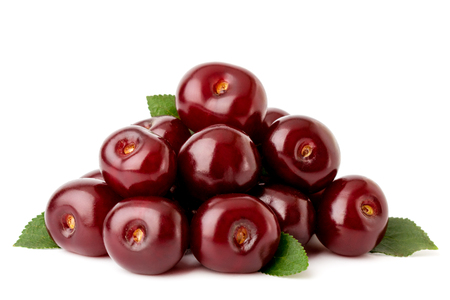 A bunch of red cherries with leaves on a white background, close-up. Isolated.
