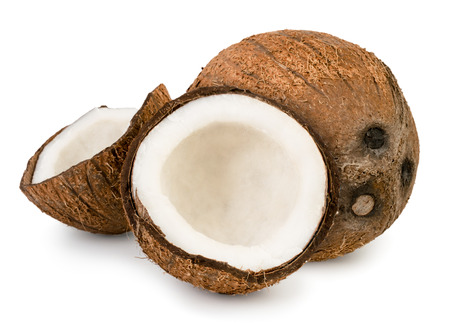 Ripe coconut and two halves on a white, isolated.